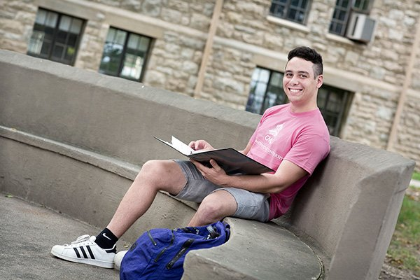 CMU student outside on campus reading